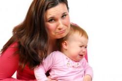 Sad mom and baby